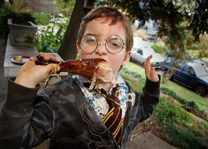 Avery eats his first turkey leg. Photo by Flash